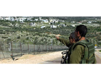 IDF soldiers conduct anti-terrorism activities near the security fence in Judea and Samaria