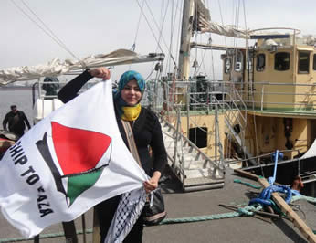 : Hanan Nasser, currently in Sweden representing herself as a student from the Gaza Strip; in the background, the Estelle (Flotilla website, June 26, 2012).