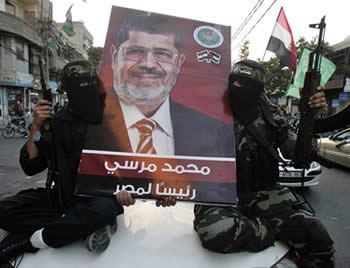 Hamas terrorist operatives celebrate the election of Mohamed Morsi (PALDF forum website, June 25, 2012)