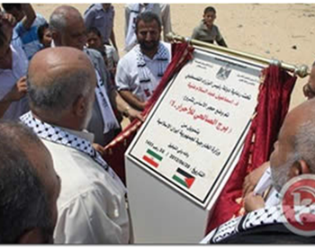 Laying the cornerstone for housing for Palestinian terrorists released from Israeli jails. According to the plaque the project was financed by Iran; both the Iranian and Palestinian flags appear on it (Paltoday website, July 9, 2012)