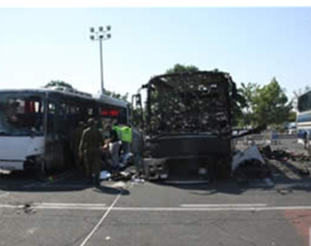 The burned-out bus at the airport in Burgas, Bulgaria (ZAKA spokesman, July 19, 2012).