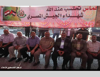 Ismail Haniya and the ministers of his de-facto administration in the mourning tent set up in Gaza City to express solidarity with the Egyptian people.