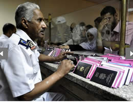 An Egyptian customs clerk examines the passports of Palestinians at the Rafah  crossing (Picture from Hamas Izz al-Din Brigades website, August 13, 2012).