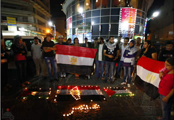 The Palestinian Authority shows solidarity with Egypt: Palestinian youth hold a candlelight vigil in the center of Ramallah to honor the Egyptian soldiers killed by terrorists
