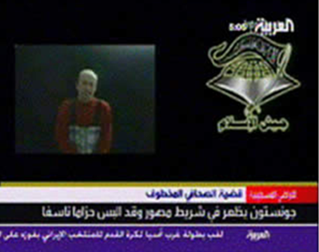 The video taken by the Army of Islam. It shows Alan Johnston strapped into an explosive belt and presents the Army of Islam's demands for his release (Picture from Al-Arabiya TV, June 25, 2007)