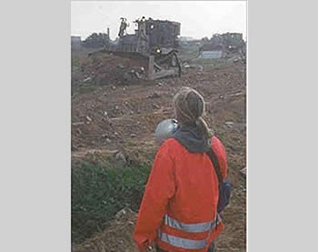Rachel Corrie and an Israeli bulldozer (Picture from Wikipedia).