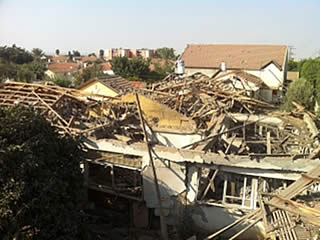 Two homes in Netivot sustained heavy damage as a result of a direct rocket hit (Photo by Daniel Hajbi for Sderot Media Center, September 9, 2012)
