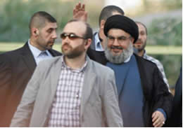 Hassan Nasrallah, surrounded by his bodyguards, arrives at Hezbollah's protest rally in Beirut's southern suburb (Al-Intiqad, Lebanon, September 17, 2012).