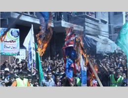 demonstrators burn United States and Israeli flags during a Hamas rally in the northern Gaza Strip (Felesteen al-Aan, September 14, 2012).