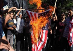 United States flag burned in front of the U.N. headquarters in Gaza (Paltoday, September 12, 2012).