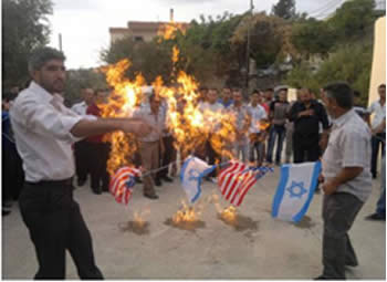 Israeli and U.S. flags burned at a protest in Al-***Akar, northern Lebanon (Al-Intiqad, Lebanon, September 23, 2012).