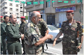 Abu Obeida al-Jarah, commander of Hamas' national security forces, visits the streets of Gaza during the exercise.