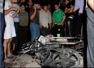 The motorbike ridden by Abu al-Walid al-Maqdisi and his aide in the Jabalia refugee camp in the Gaza Strip (Wafa News Agency, October 13, 2012).