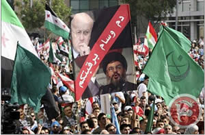 Mourners wave a banner accusing Hassan Nasrallah and Lebanese Prime Minister Miqati of responsibility for al-Hassan's assassination (Ma'an News Agency, October 21, 2012).