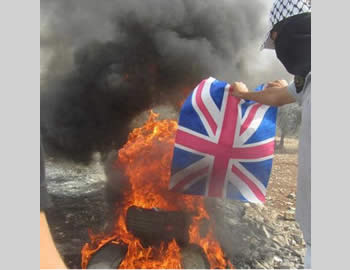 Demonstrators in the village of Qadoum burn the British flag (Facebook page of PALQA, November 2, 2012).