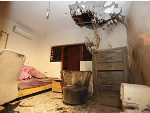 A home in Sderot takes a direct hit (Photo by Edi Israeli, courtesy of NRG, November 11, 2012).