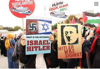 Signs equating Nazism with Zionism at a demonstration in front of the court house in Istanbul.