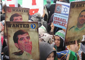 Pictures of the ''wanted'' Israelis and a swastika (The PIJ's PalToday website, November 6, 2012).