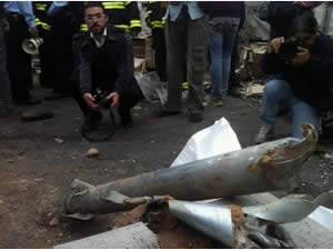 The remains of a rocket which hit the yard of a factory in Netivot (Photos by Daniel Hagbi for the Sderot Media Center, November 12, 2012).