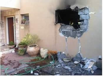 A house in a western Negev village takes a direct hit (Sderot Media Center, November 17, 2012).
