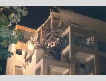 Severe damage done by a direct Fajr-5 hit to a residential dwelling in Rishon Letzion