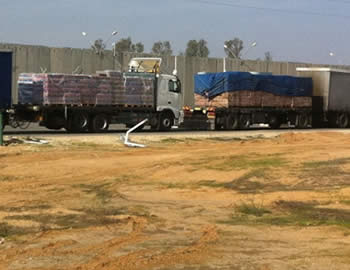 Trucks making deliveries to the Gaza Strip through the Kerem Shalom crossing