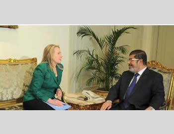 American Secretary of State Hillary Clinton and Egyptian President Mohamed Morsi discuss the terms of the ceasefire agreement (Mohamed Morsi's Facebook page, November 21,  2012).