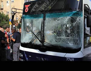 The bus after the attack (Israel Police Force Facebook page, November 21, 2012).