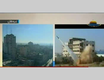 Rockets fired near a building in the Gaza Strip (at right) (Hamas' Al-Aqsa TV, November 14, 2012)