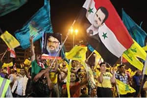 Hezbollah activists in Lebanon hold a pro-Assad rally (Ilaf website, from All4Syria, July 2011).