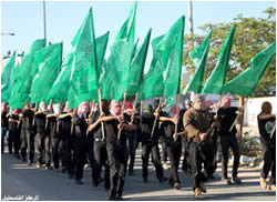 The Izz al-Din al-Qassam Brigades on parade for the 25th anniversary of the founding of Hamas (Palestine-info website, December 3, 2012).