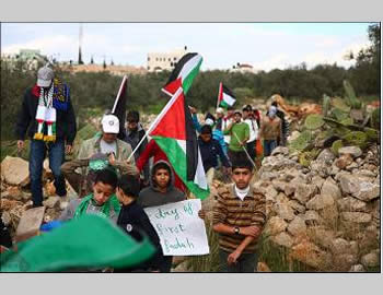 Hamas symbols at the weekly demonstration against the security fence in Ni'lin