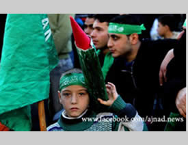 Hamas flags and a model of rockets at the Hamas rally in Qalqiliya, December 15, 2012 (Ajnad Facebook page, December 15, 2012).