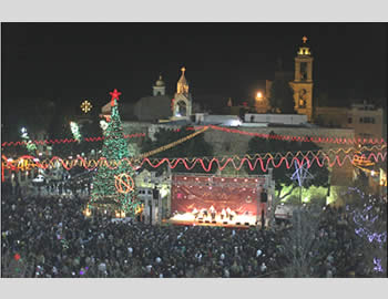 Christians celebrate Christmas Eve in the courtyard of the Church of the Nativity in Bethlehem