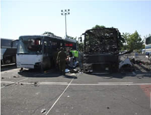 The burned-out bus at the scene of the attack at the Burgas airport (Photo courtesy of the ZAKA spokesman, July 19, 2012).