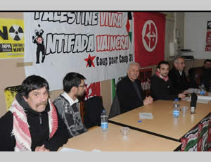 Abu Sami (third from left) at the meeting in Toulouse; to his left is the PFLP poster (Ladepeche.fr website, December 9, 2012).
