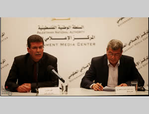 Qadoura Fares (left), chairman of the Palestinian prisoners' club, and Issa Qaraqa (right), Palestinian minister of prisoners' affairs, hold a press conference in Ramallah.
