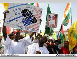 African students carrying a poster condemning Israel and the United States and waving (left) the Hezbollah flag.