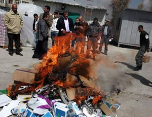 Products allegedly manufactured in the settlements and confiscated from Palestinian merchants are burned (Filastin Al-'Aan, March 11, 2013).