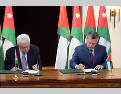 Mahmoud Abbas and King Abdallah sign the agreement reconfirming Jordan's role in responsibility for the Muslim and Christian holy places in Jerusalem