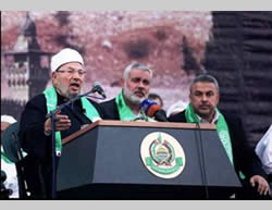 Sheikh Yusuf al-Qaradawi (left) speaks at the rally organized by Hamas in his honor in the Al-Katiba Square in Gaza City