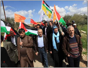 Salam Fayyad, then Palestinian prime minister participates in a demonstration in Bila'in for the eighth anniversary of