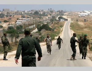 The security forces of the de-facto Hamas administration deploy along the Rafah border with Egypt.