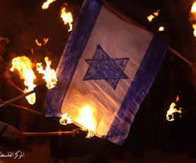 An Israeli flag is burned during a torchlight Nakba Day march in Gaza City