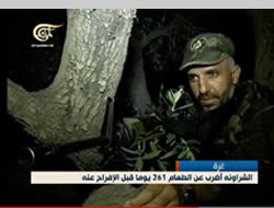A uniformed Ayman al-Sharawneh in an observation post or ambush position after having gone back to terrorist activity in the Gaza Strip