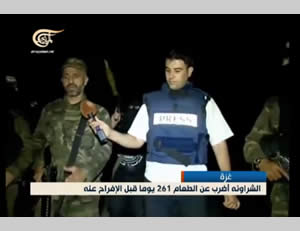 The reporter accompanies Ayman al-Sharawneh on a night operational activity.