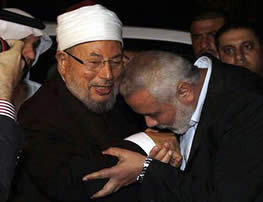Ismail Haniyeh, head of the de-facto Hamas administration, kisses Al-Qaradawi's hand during the sheik's visit to the Gaza Strip (ikhwanonline.com, May 10, 2013)