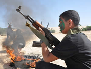 Children learn how to fire automatic weapons at a Palestinian Islamic Jihad summer camp