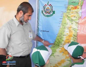 One of the camp counselors explains the map of Palestine, according to which the State of Israel does not exist
