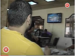 Patrons in a Gaza Strip coffee house follow the events in Egypt (Ma'an News Agency, June 30, 2013).